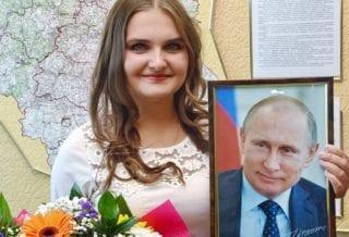 Захарова с фото президента